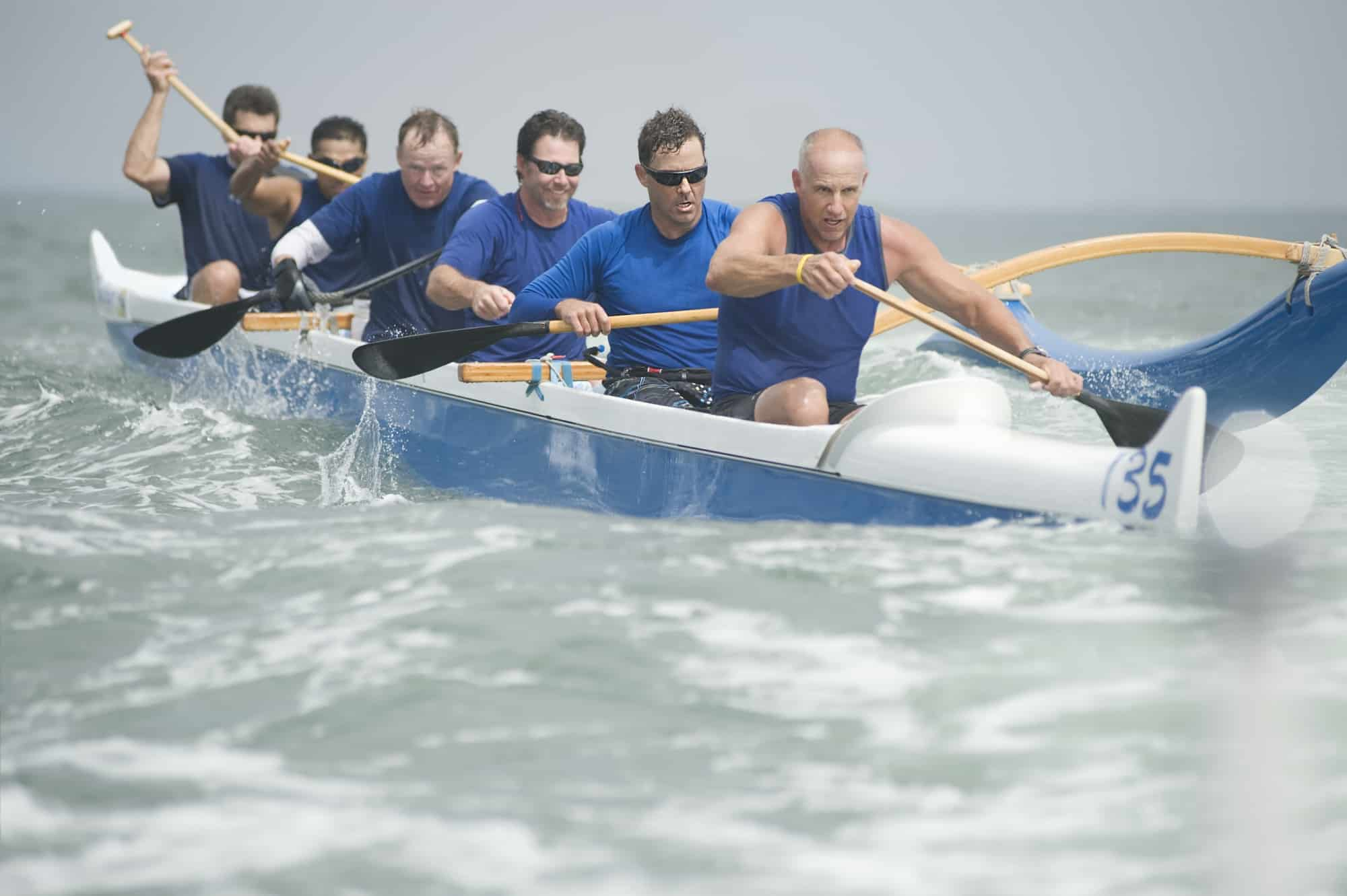 Rowing Team In Outrigger Boat