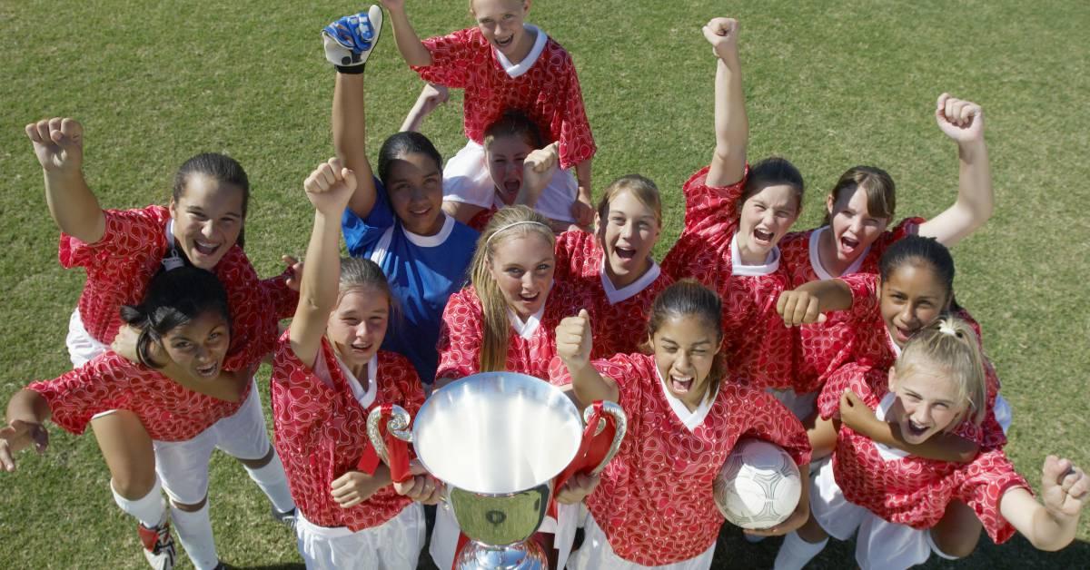 Girls Team Winning Trophy Image